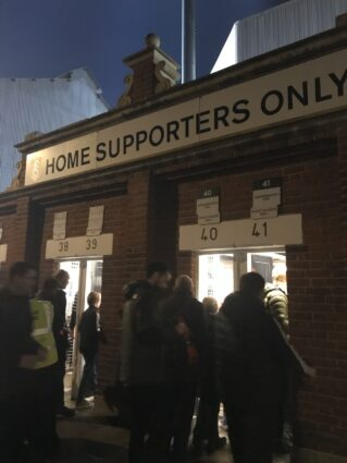 fans enter turnstiles Craven Cottage