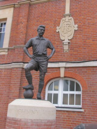 Statue of Johnny Haynes outside Fulham FC's football ground.