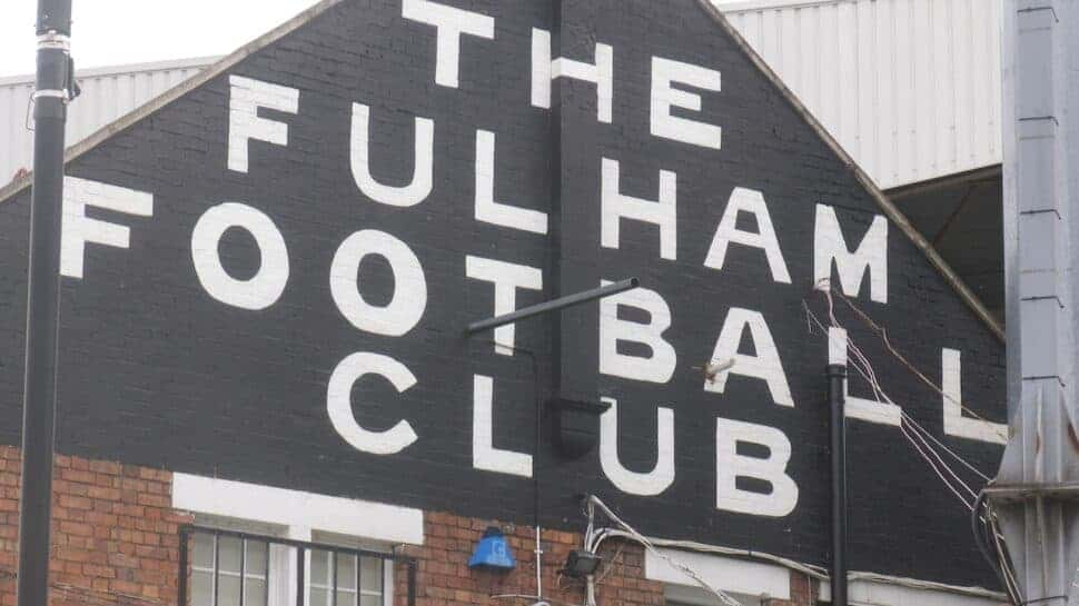 """""""The Fulham Football Club"""" written on the side of Craven Cottage in London."""