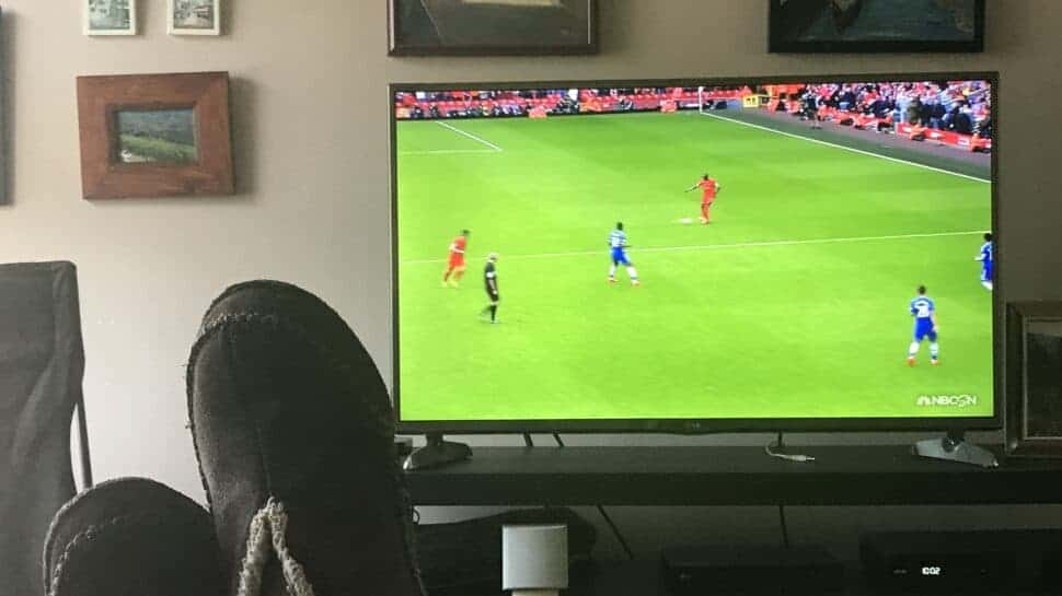 person watching soccer on tv in America at home