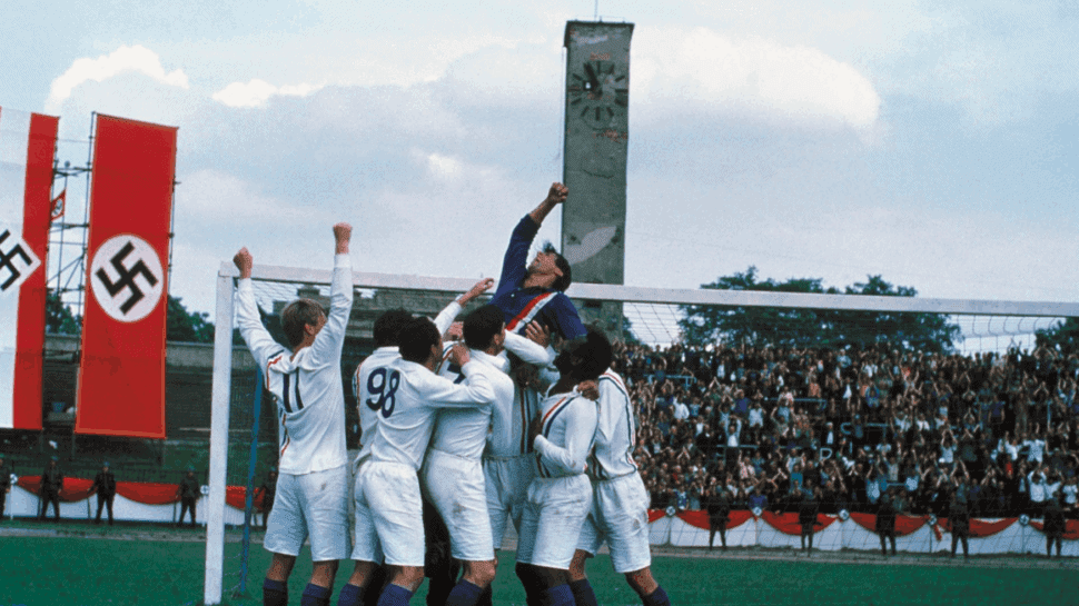 Nazi flag soccer players lift Sylvester Stallone in Escape to Victory movie