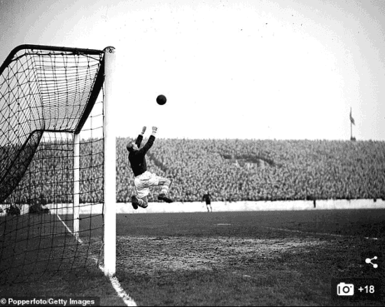archive black & white photo of bert trautmann playing goal for manchester city