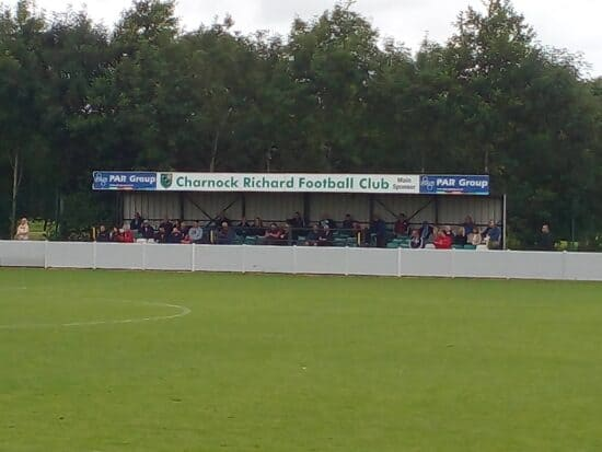 Supporters in a tiny stand at Charnock Richard Football Club.