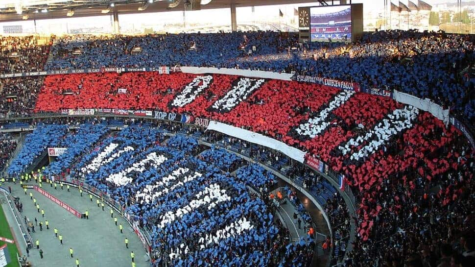 PSG fans create a colorful display before a soccer game.