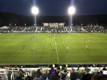 view of soccer clubs on pitch