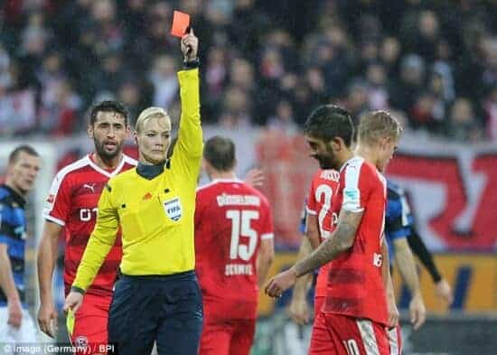 Bibiana Steinhaus female referee gives red card to male soccer player