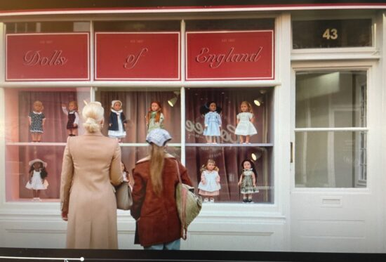 """Two """"Ted Lasso"""" characters looking at a doll shop."""