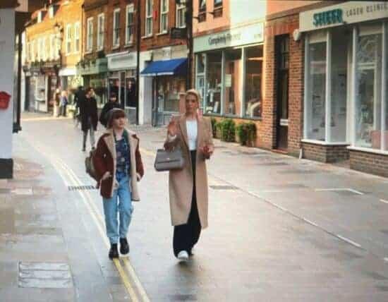 "Two women walking down a street in a scene from ""Ted Lasso"""