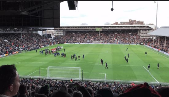 View of a football game from behind the goal at Craven Cottage, home of Fulham FC