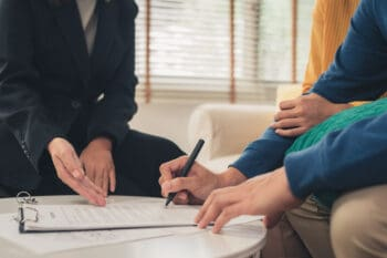 couple signing travel insurance contract