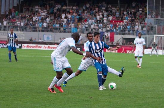 FC Porto player battling opponents for soccer ball