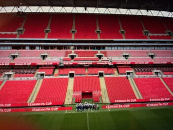 """screenshot from """"ted lasso"""" of soccer players at wembley stadium"""