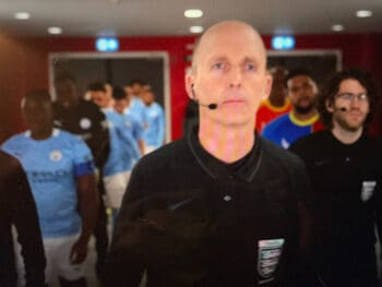 referee mike dean leading the players out of the tunnel at Wembley