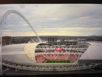 """screenshot from """"ted lasso"""" of wembley stadium roof"""