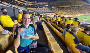 smiling woman with bag of water at soccer game