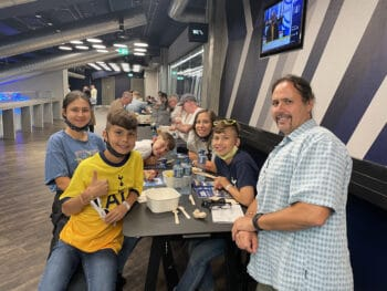 smiling family in Spurs hospitality lounge