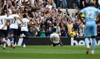fans cheering Son sliding celebration after goal