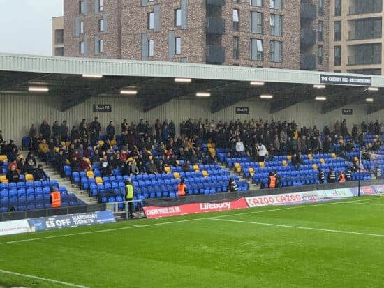 fans in the away end at AFC wimbledon
