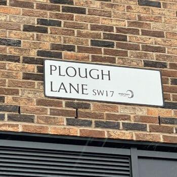 sign reading Plough Lane, SW London