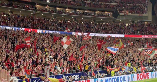 fans celebrating behind the goal at Wanda Metropolitano Stadium